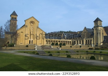 Abbey in Orval in belgium is famous for its trappist beer, botanical garden and ruins of former seat of monastery - nowadays accesible to tourists. - stock photo