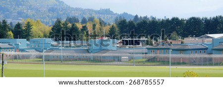 ABBOTSFORD, BC/CANADA - APRIL 11, 2015: Matsqui Institution, as seen on April 11, 2015,  is a federal medium-security prison facility in Abbotsford, British Columbia - stock photo