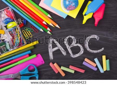 ABC alphabet, blackboard, school desk, preschool basic education - stock photo