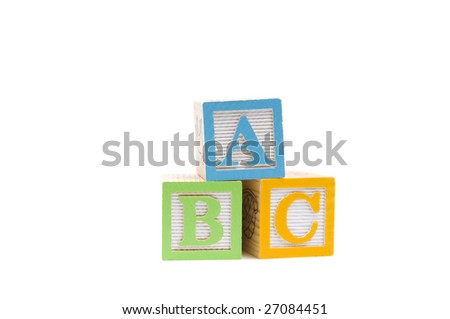 ABC in wooden child blocks on a white background - stock photo