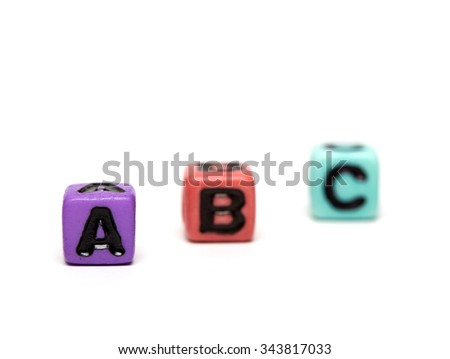abc - word made from multicolored child toy cubes with letters - stock photo