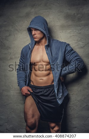 Abdominal man in a blue hoodie. - stock photo