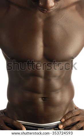 abdominal muscle of black man - stock photo