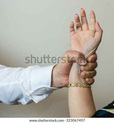 Abductor, forceful  man's hand on a female, imposing his will on a woman or girl friend. - stock photo