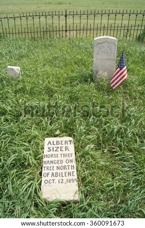 ABILENE, KANSAS/USA JUNE 30, 2015: Gravestone of Albert Sizer, a horse thief hanged in 1859. Historical records indicate 93 horse thieves were lynched in Kansas from 1850 -1880.  - stock photo