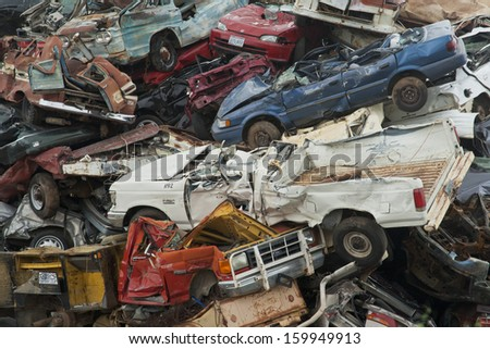 Abilene, Texas - October 10: Discarded cars and trucks are piled up high in a scrap heap outside Abilene, Texas on October 10, 2013. - stock photo