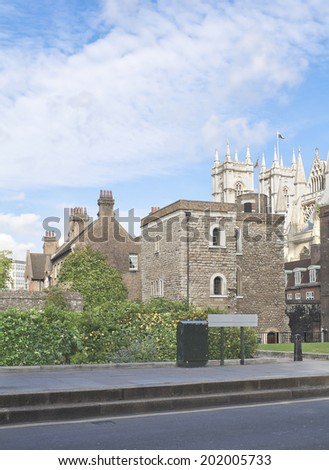 Abingdon street with view of Westminster Abbey in London, England - stock photo