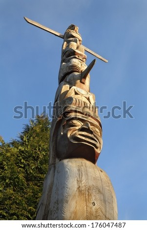 Aboriginal Totem Pole, Vancouver. Low angle view of a Stanley Park totem pole, Vancouver, British Columbia, Canada.  - stock photo