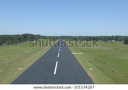 Above a small runway on take off. - stock photo