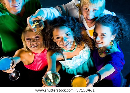 Above angle of happy friends cheering up at party - stock photo