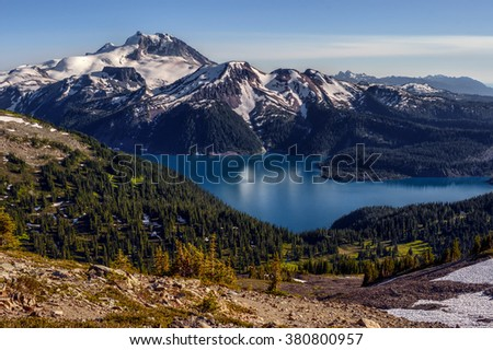 Above, overlooking the glacial lake and mountains on the background - stock photo