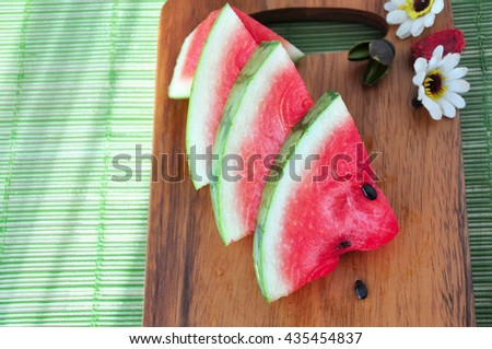 Above pieces of fresh watermelon put on wooden board - stock photo