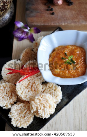 Above shot of Thai food rice cracker with dip sauce - stock photo