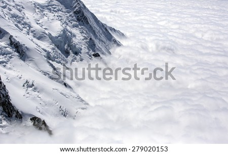 above the clouds in mont blanc in the french alps - stock photo
