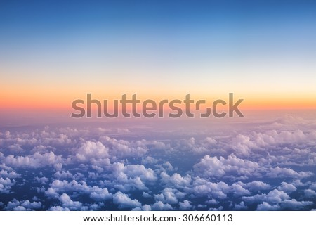 Above The Clouds Photo of puffy clouds, sunset shot - stock photo