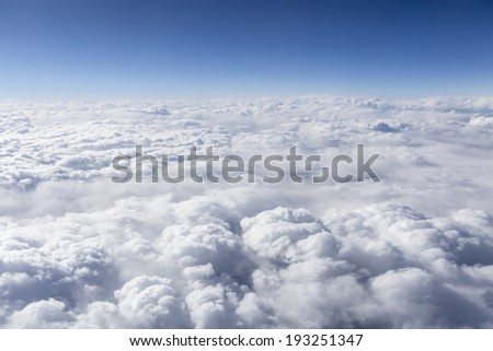 Above the cloudscape aerial pilot point of view. - stock photo