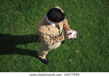 Above view of a business man writing something - stock photo