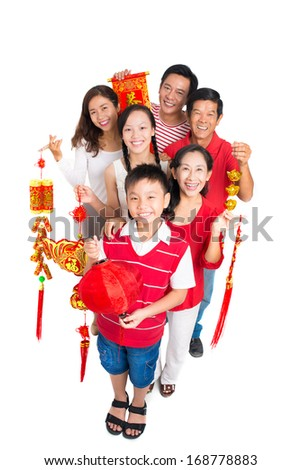 Above view of a happy family welcoming to celebrate Tet holiday isolated on white  - stock photo