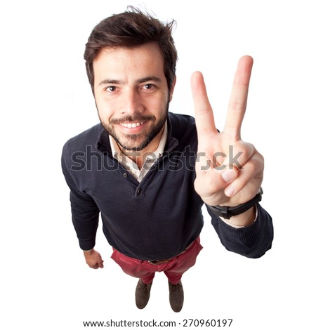 above view of a young man showing victory sign. View from the top - stock photo