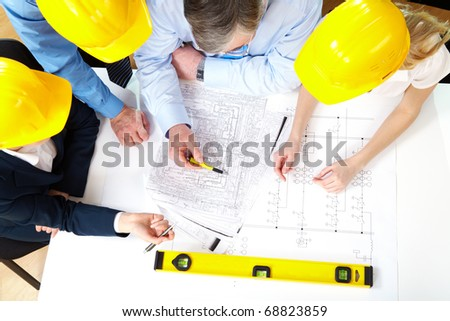 Above view of architects planning a house project - stock photo