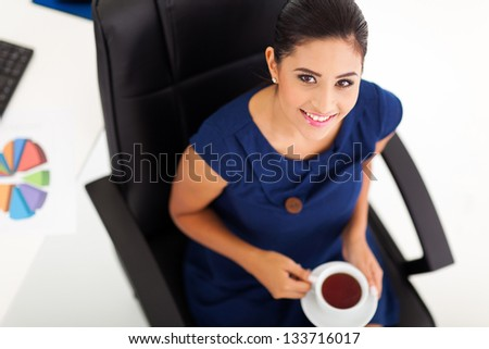 above view of beautiful businesswoman having tea - stock photo