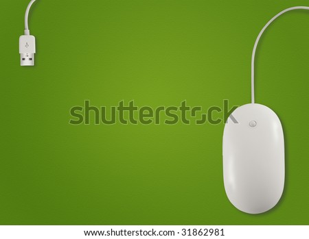 Above view of computer mouse with on green background - stock photo