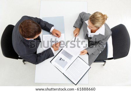 Above view of confident boss with secretary planning their work - stock photo