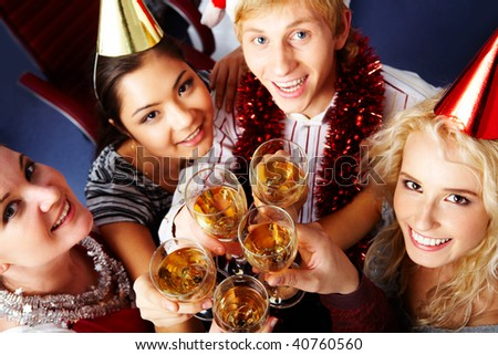 Above view of glad people toasting at party - stock photo