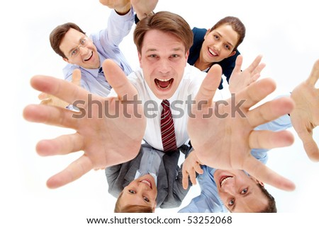 Above view of happy chief surrounded by several partners looking upwards - stock photo