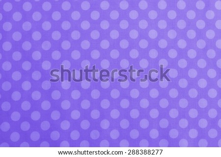 Above View of Polka Dot Woven, Cotton Fabric for a Colorful, two-tone Monochromatic Medium blue purple Background Template, use horizontal or vertical with room or space for text, copy, words. Photo - stock photo