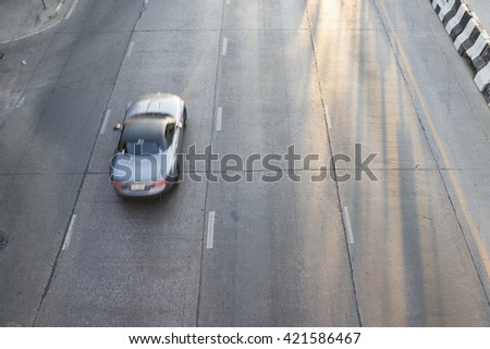 above view of road and a car moving and blurry ,selective focus at road - stock photo
