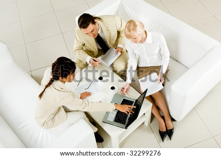 Above view of successful business partners discussing new project and consulting at meeting - stock photo