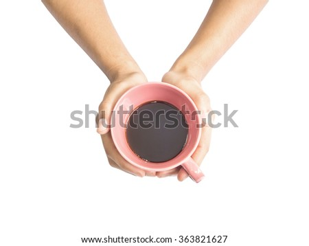Above view of two hands holding a pink cup of coffee, isolated - stock photo