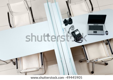 Above view of two tables separated by border with chairs near by - stock photo