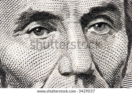 Abraham Lincoln close up from 5 dollar bill - stock photo