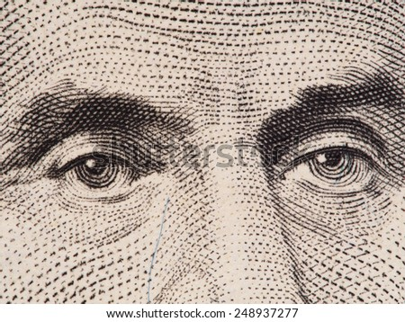 Abraham Lincoln eyes extreme macro on US 5 dollar bill, united states money closeup, 2003 series - stock photo