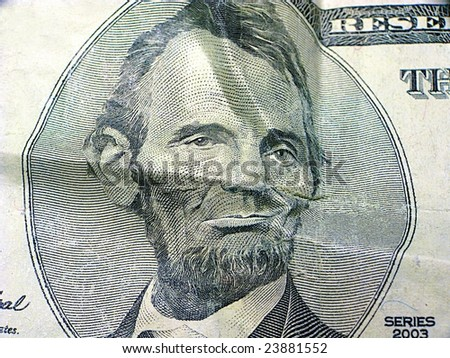 Abraham Lincoln looking unamused at the state of the economy - stock photo