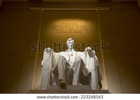 Abraham Lincoln Statue at Lincoln Memorial - Washington DC, United States. Illuminated at night. - stock photo
