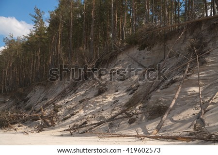 Abrasion of shore in Slowinski National Park at Baltic Sea in Poland strict protection area - stock photo