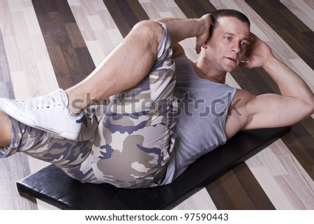 Abs exercise in the gym - stock photo