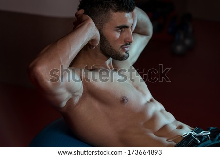 Abs Workout - Exercising Abdominals In Fitness Club - stock photo