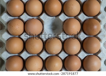 Absent concept : An egg disappears from the group of eggs. - stock photo