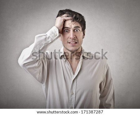 absent-minded man - stock photo