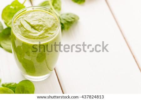 Absolutely Amazing Tasty Green Avocado Shake or Smoothie, Made with Fresh Avocados, Banana,Milk on Light White Wooden Background, Raw Food, Vegan Drink, Vegan Food Conception, Free Space for Text - stock photo