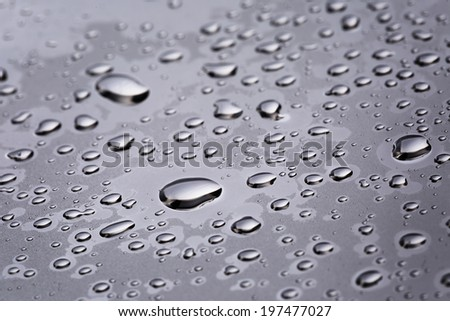 abstact water drops on poniched stainless steel surface, close up - stock photo