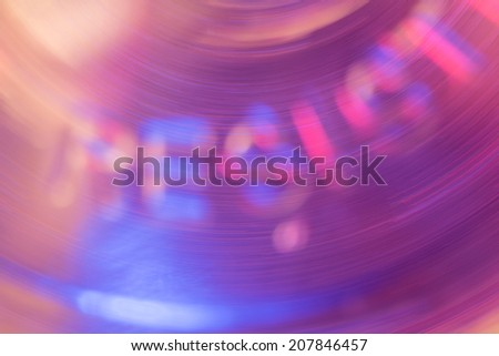 Abstract. A rotating liquid shape forms the blurry letters RESIST in it's background. - stock photo