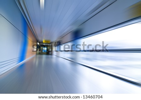 Abstract airport interior, blurred expressing movement. - stock photo