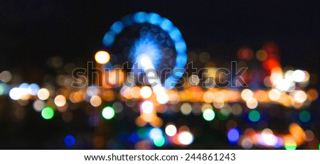 Abstract amusement park, defocused, blurred - stock photo