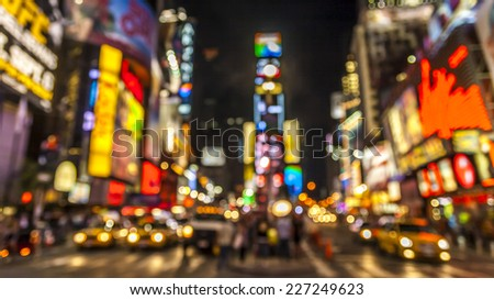 Abstract and conceptual view of New York city in the USA showcasing The lights of Times Square at night. - stock photo