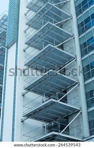 Abstract architectural Building exterior of steel staircase - Color tone effect - stock photo